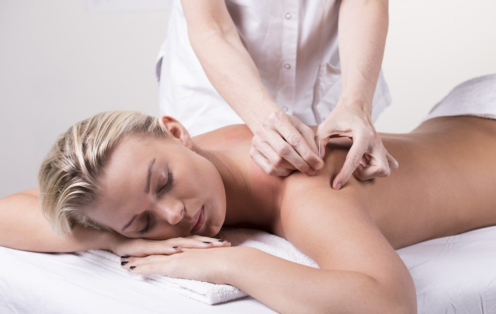 Chiropractor dry needling a relaxed woman
