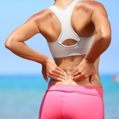 Fit woman with back pain