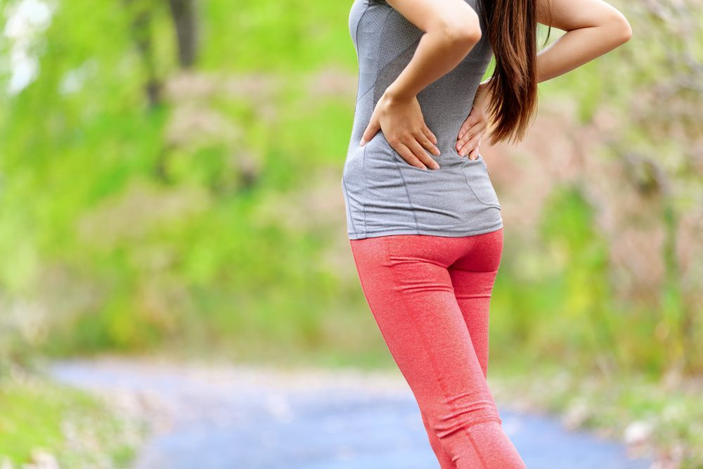 Woman on a run with lower back pain