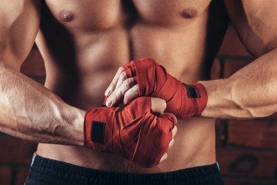 MMA Fighter with red hand wraps
