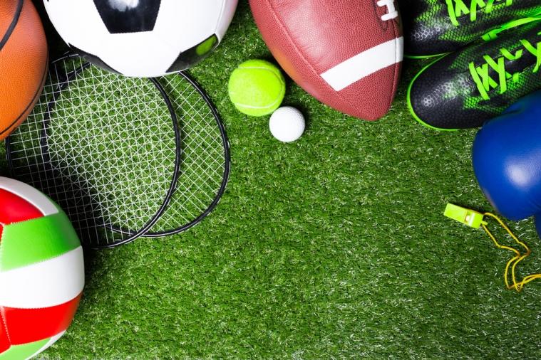 Various sport balls on grass